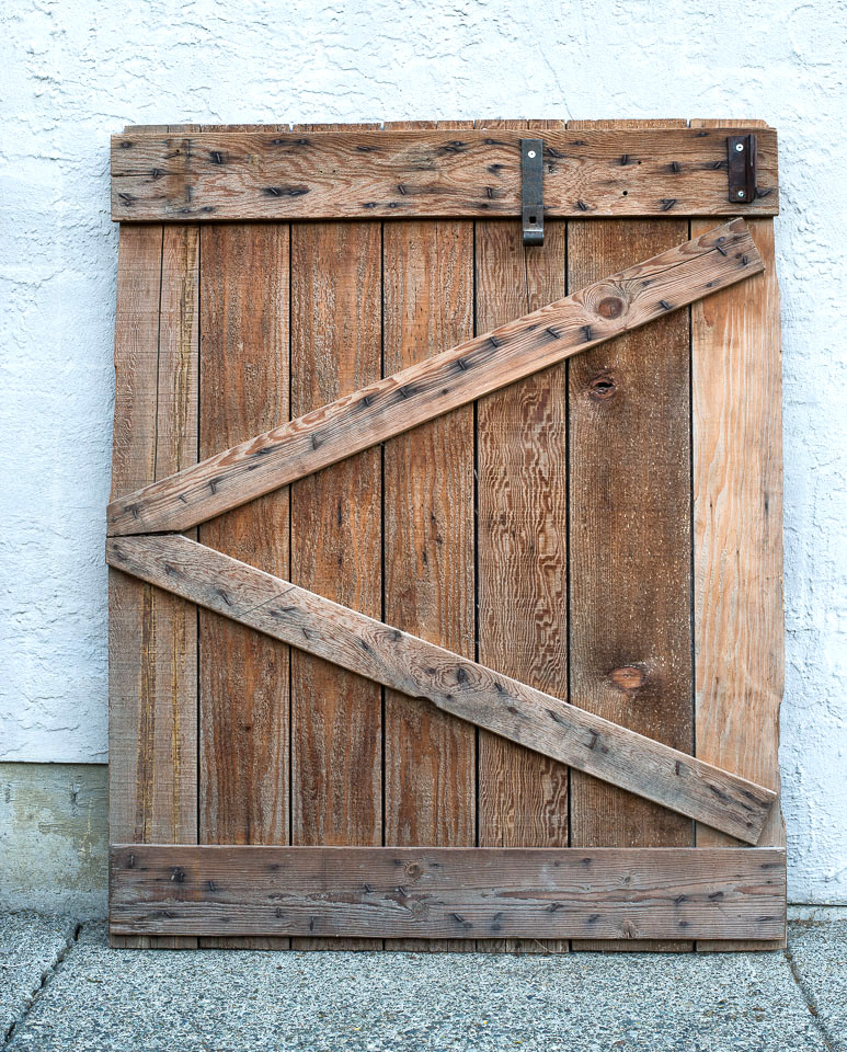 Rustic barn gate that use to hang bathroom towels.