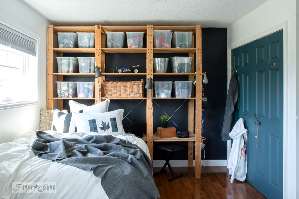 boy's bedroom, with ikea floor to ceiling storage against a black wall