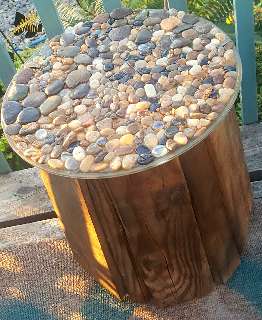 Rustic pebble and reclaimed wood side table from a bucket, by Make The Best Of Things, featured on Funky Junk Interiors