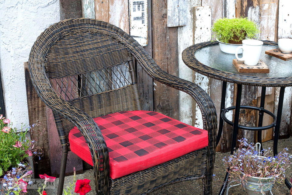 buffalo checked seat cushion for an outdoor bistro area| funkyjunkinteriors.net