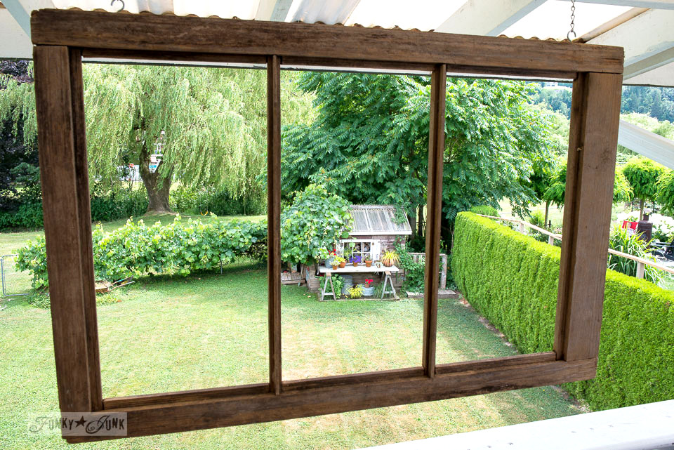 Old windows hung in patio openings for a rustic touch | funkyjunkinteriors.net