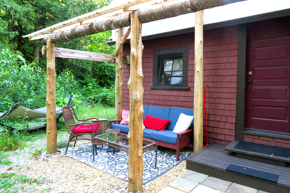 Outdoor patio living room at the Othello cabin riverfront getaway at Eco Retreat in Hope, BC Canada | funkyjunkinteriors.net