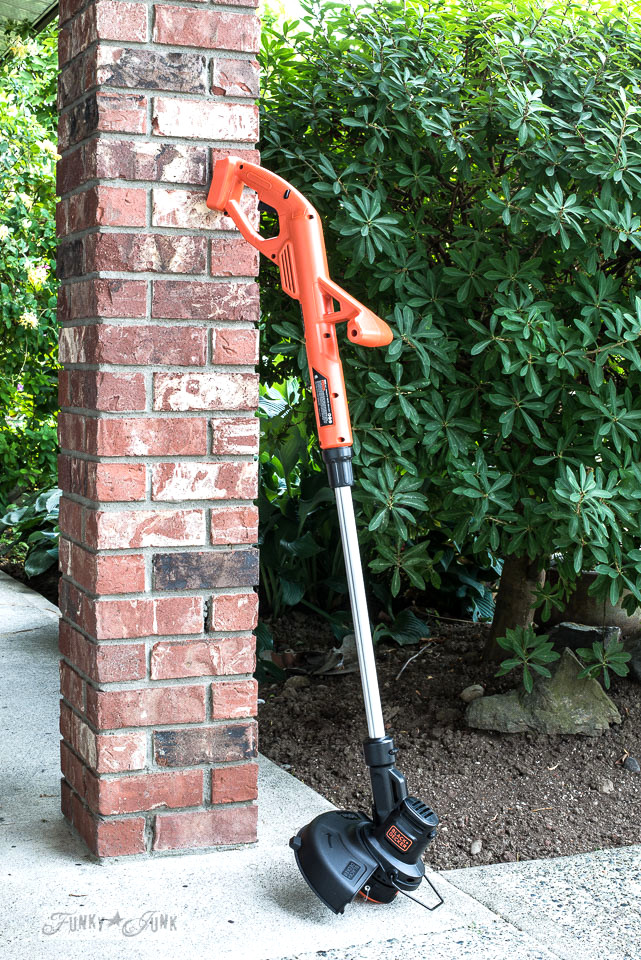 Tools for women - a light duty Black + Decker weed trimmer and edger. Easy to use! Part of Basic Must-have tools for DIYers