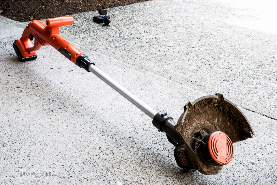 Twisting the head to become a grass edger, part of My newest weed trimmer which is a Black + Decker 20V String Trimmer / Edger LST201. And why I love it! funkyjunkinteriors.net
