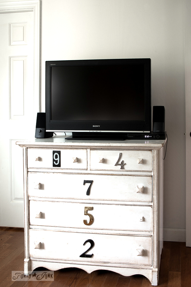 White numbered dresser used as a TV media stand in a bedroom | funkyjunkinteriors.net