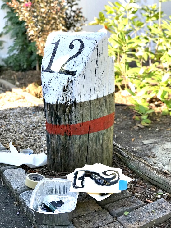 Stenciled stump buoy house number by Homeroad, featured on Funky Junk Interiors