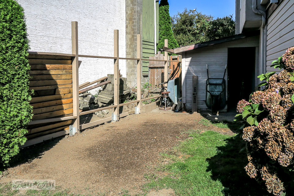 Garden compost and shed area gets cleaned up and seeded, ready for new fence planks! | funkyjunkinteriors.net
