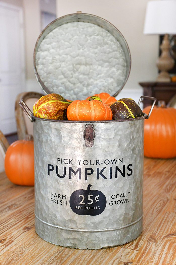 Galvanized farmhouse pumpkin bucket by How To Nest For Less, featured on Funky Junk Interiors