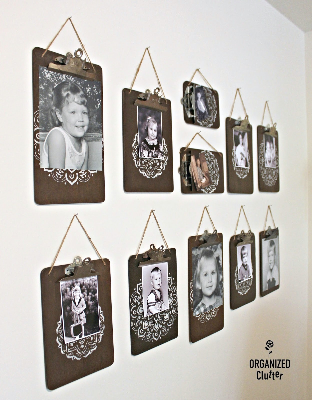 Clip board picture frame wall gallery by Organized Clutter, featured on Funky Junk Interiors