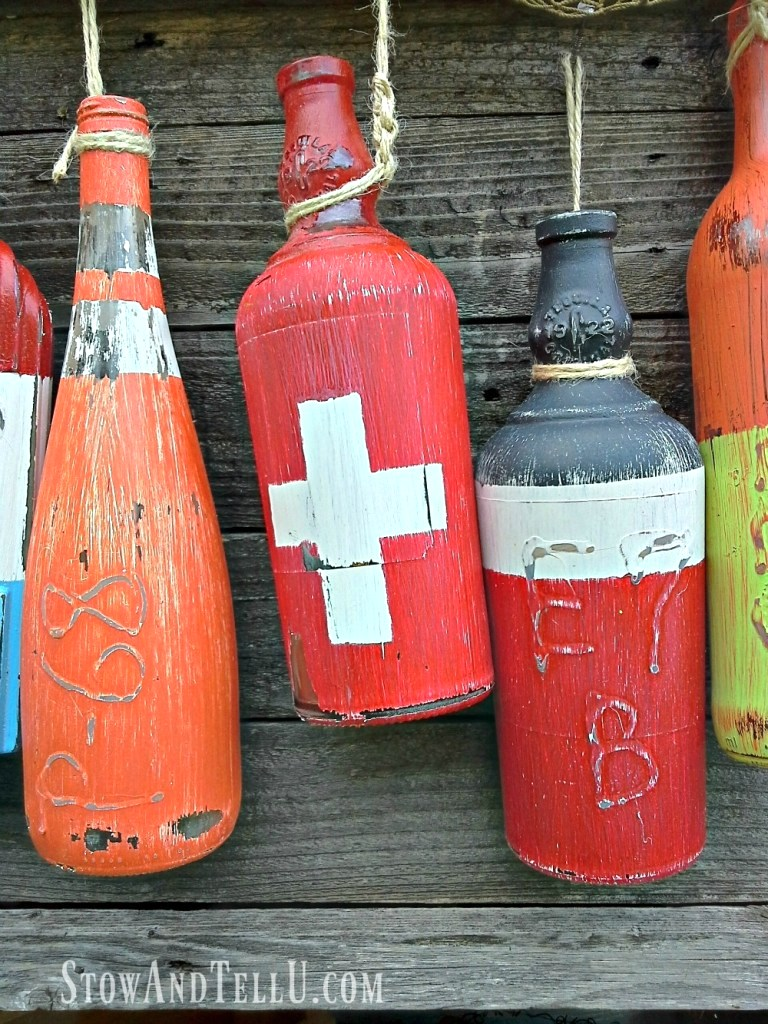 Fishing buoys from bottles by Stow and Tell U, featured on Funky Junk Interiors