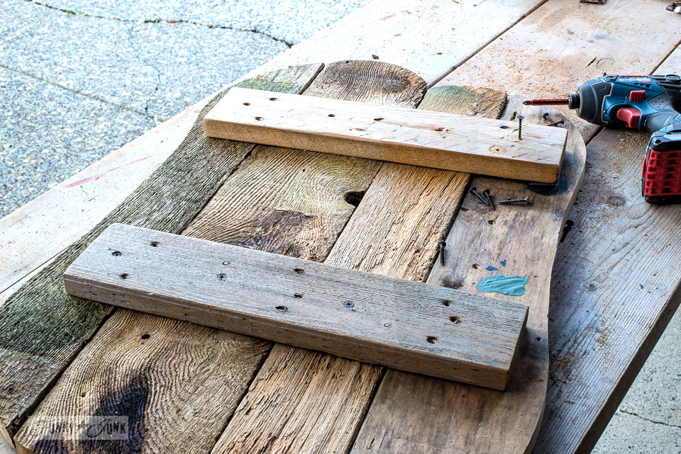 Bracing the back of a reclaimed wood fall pumpkin sign | funkyjunkinteriors.net