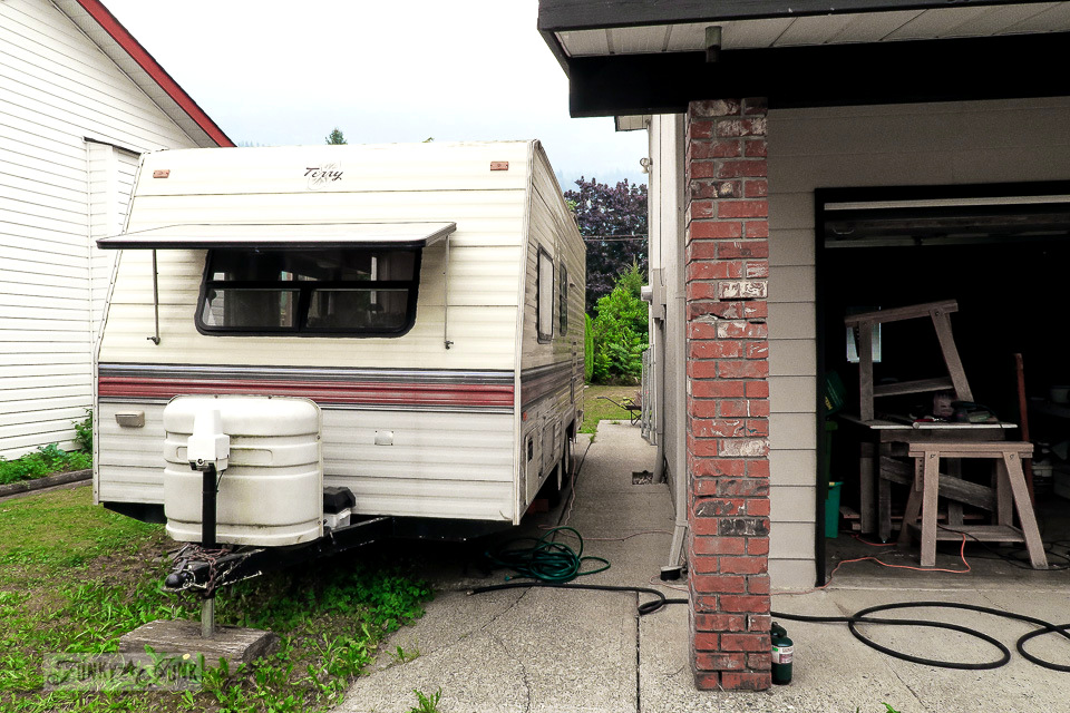 travel trailer parked along the side of the house