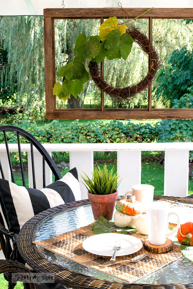 A fall patio wicker resign rattan table setting with old windows, windsor chairs, and pattern stenciled rattan placemats / | funkyjunkinteriors.net