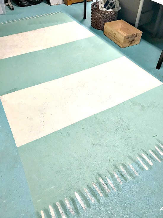 How to paint an area rug on a cement floor by Homeroad, featured on Funky Junk Interiors