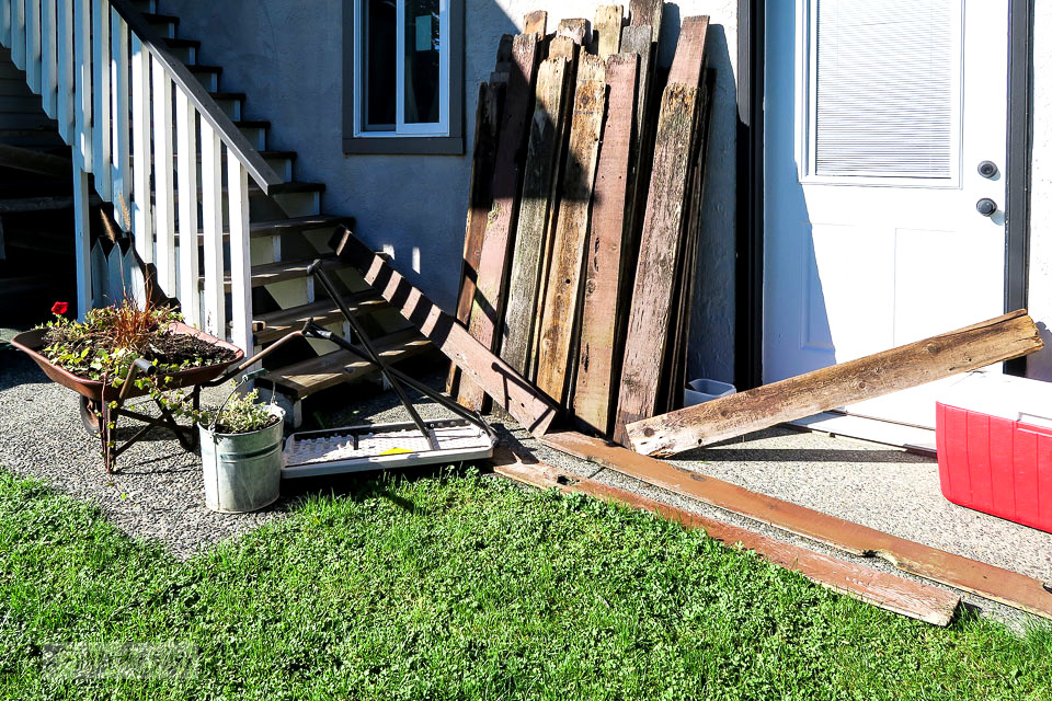 Fence boards blown over after a wind storm