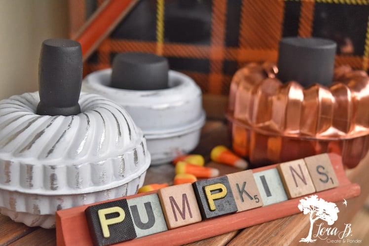 Tart mold and scrabble pumpkin art by Lora B, featured on Funky Junk Interiors
