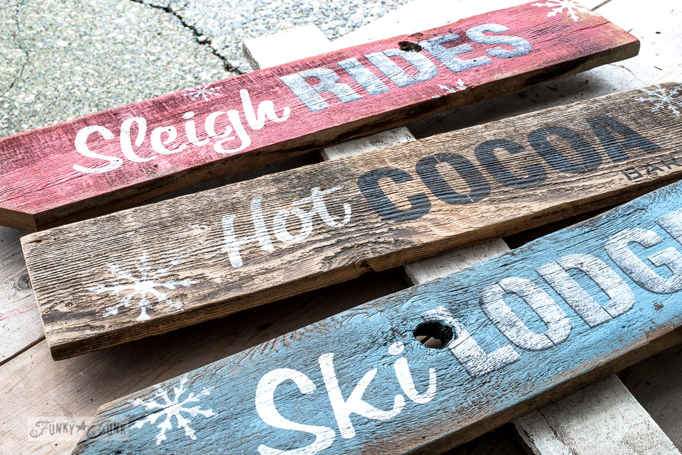 Super festive and fun Christmas and winter directional signs using stencils and reclaimed wood planks! Made with Funky Junk's Old Sign Stencils Sleigh Rides, Hot Cocoa and Ski Lodge, and Fusion Mineral Paint. Click here for the tutorial on funkyjunkinteriors.net