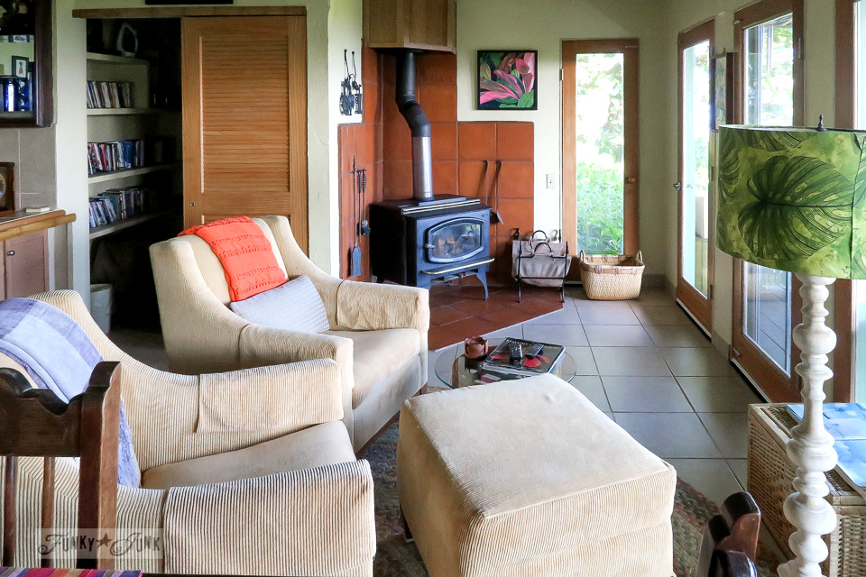The sitting area and wood stove inside the charming and quaint Entabeni Cottage in Nahiku, buried in a tropical forest, part of our Road to Hana adventure in Maui, Hawaii. Read the full story at funkyjunkinteriors.net