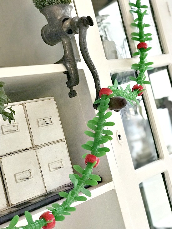 Repurposed apple sauce tab Christmas garland by Homeroad, featured on Funky Junk Interiors