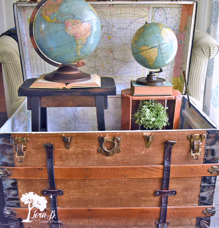 Travel map lined trunk refresh by Lora B, featured on Funky Junk Interiors