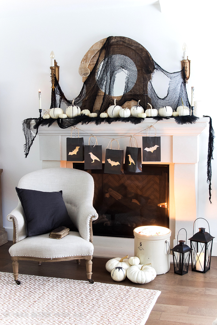 Halloween mantel with paper bag garland by So Much Better With Age, featured on Funky Junk Interiors
