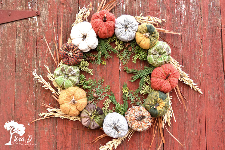 Fabric fall pumpkin wreath by Lora B, featured on Funky Junk Interiors