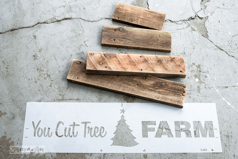 Learn how to make this charming, rustic pallet wood You Cut Tree Farm Christmas sign using Funky Junk's Old Sign Stencils and Fusion Mineral Paint! Click to visit full tutorial.