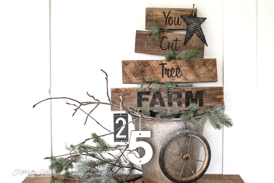 Creating a stencil pattern - Learn how to make this charming, rustic pallet wood Christmas You Cut Tree Farm sign using Funky Junk's Old Sign Stencils and Fusion Mineral Paint. Click to full tutorial.