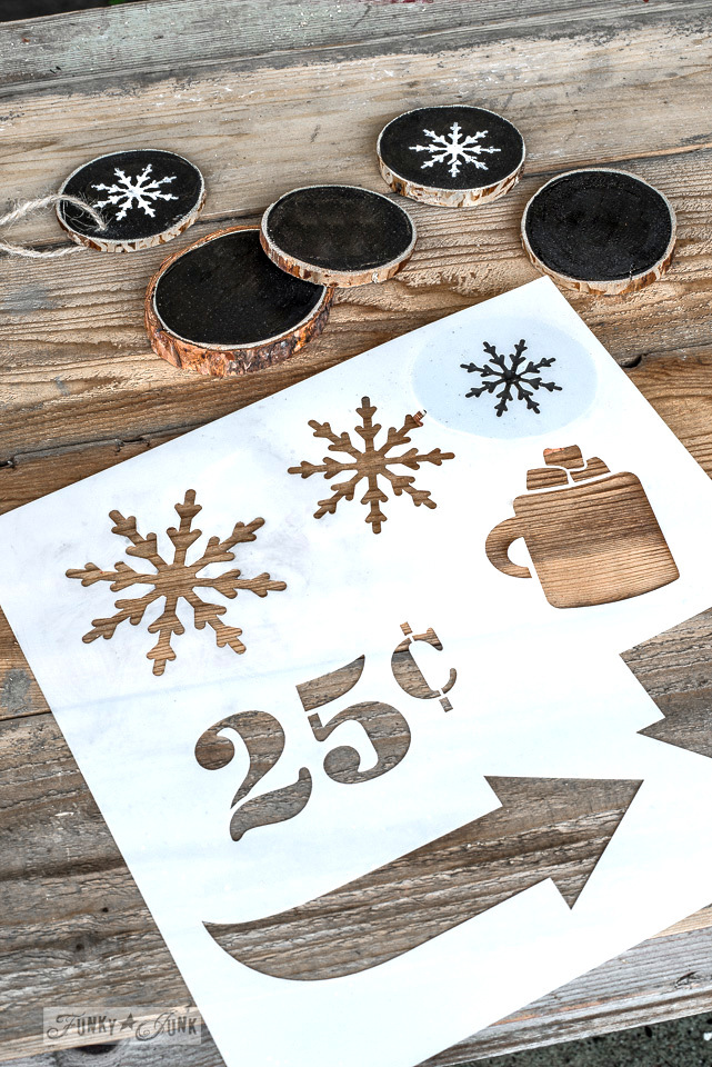 Painting out wood slices with Fusion Mineral Paint's Coal Black and Casement to create snowflake Christmas ornaments with Funky Junk's Old Sign Stencils. Full tutorial at funkyjunkinteriors.net