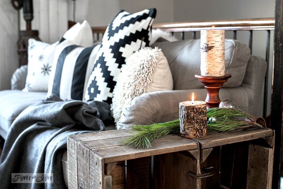 Bark candles on a rustic crate side table beside the Stocksund Ikea sofa with black and white pillows, part of Funky Junk's Christmas home tour. See it all at funkyjunkinteriors.net #christmas