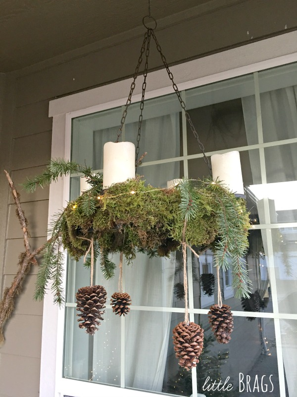 Christmas front porch with mossy candle chandelier by Little Brags, featured on Funky Junk Interiors