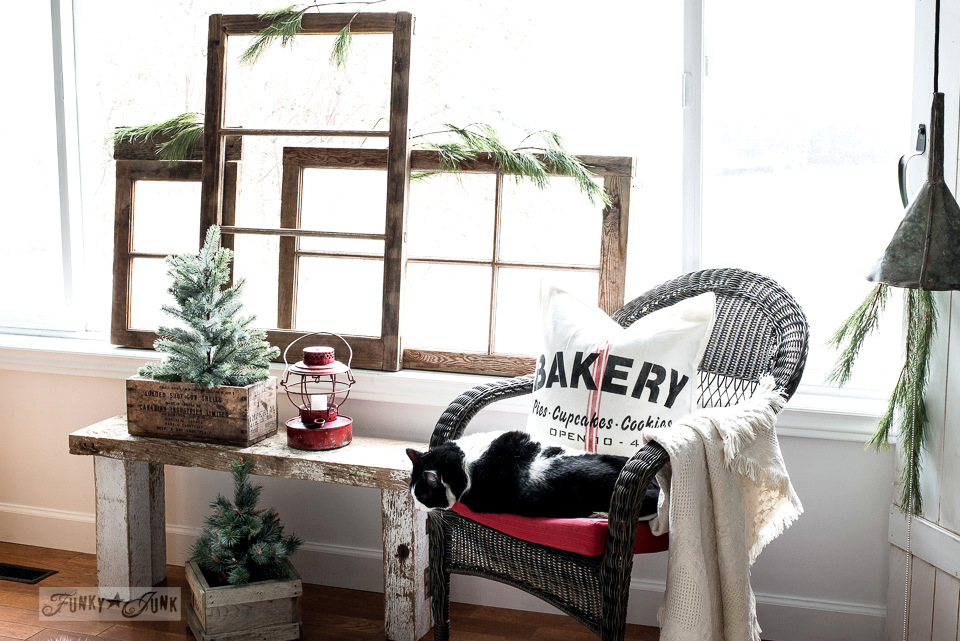Vintage windows along a picture window with a Bakery vintage inspired grainsack pillow made with Funky Junk's Old Sign Stencils and Fusion Mineral Paint | tutorial on funkyjunkinteriors.net #oldsignstencils #funkyjunkinteriors #pillows #christmasdecor