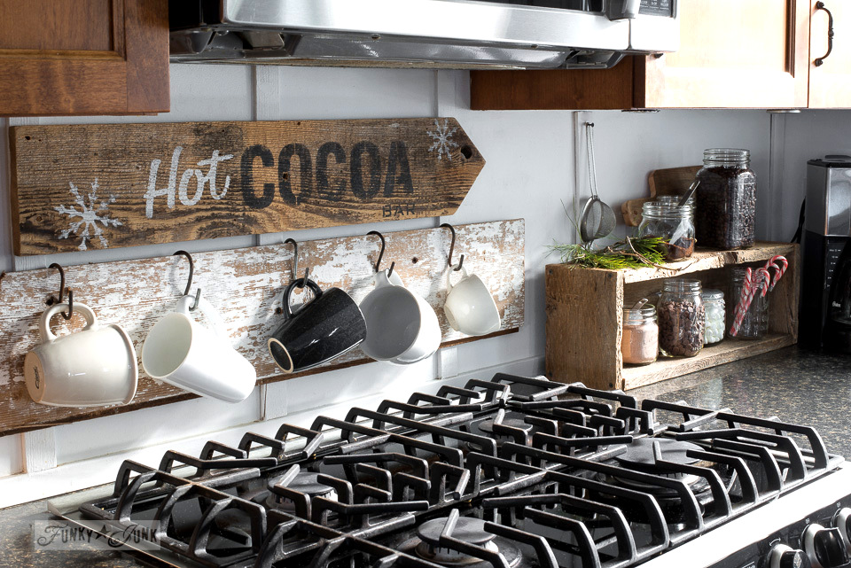 Hot Cocoa rustic signs and mug hanging and cocoa station in an industrial farmhouse kitchen, part of Funky Junk Interiors' Christmas home tour. See it all at funkyjunkinteriors.net #christmas