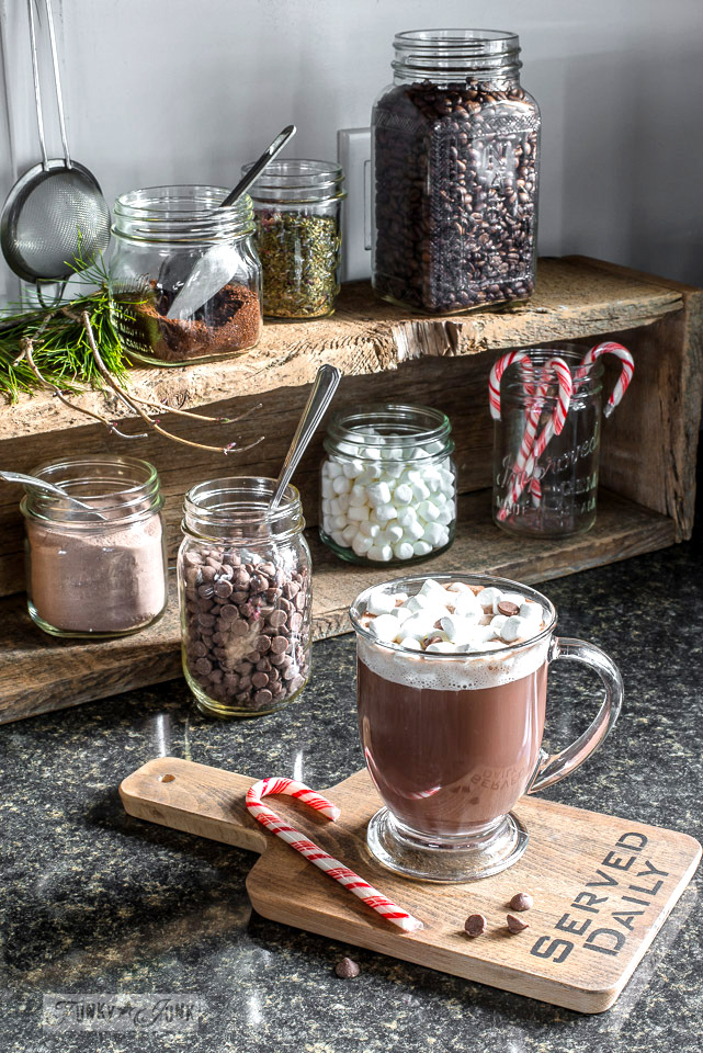 Make a charming hot cocoa bar with a simple crate and cute cutting board serving as a coaster! Part of a Christmas Home Tour - click to view.