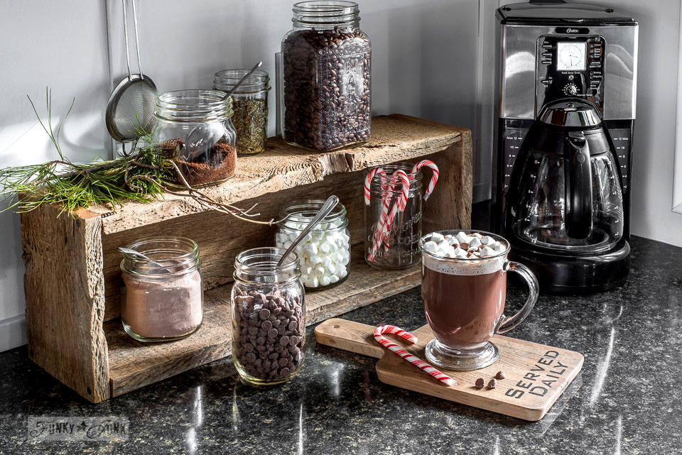 Learn how to make a variety of different rustic coffee stations using crates, benches, and more! Shown is a charming hot cocoa station made with a crate.