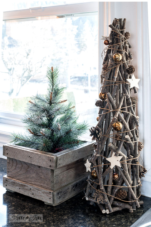 Tall twig with copper ornaments Christmas tree from Urban Barn, with mini Christmas tree in a crate from Lowes, part of Funky Junk Interiors' Christmas home tour. See it all at funkyjunkinteriors.net #christmas
