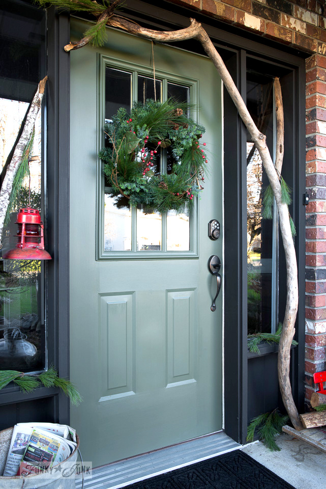 Sage green front door painted in Bayberry from Fusion Mineral Paint, decked out with branches and wreath for Christmas, part of Funky Junk Interiors' Christmas home tour. See it all at funkyjunkinteriors.net #christmas