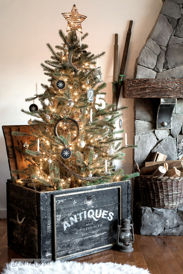 Christmas tree in a stenciled Antiques crate