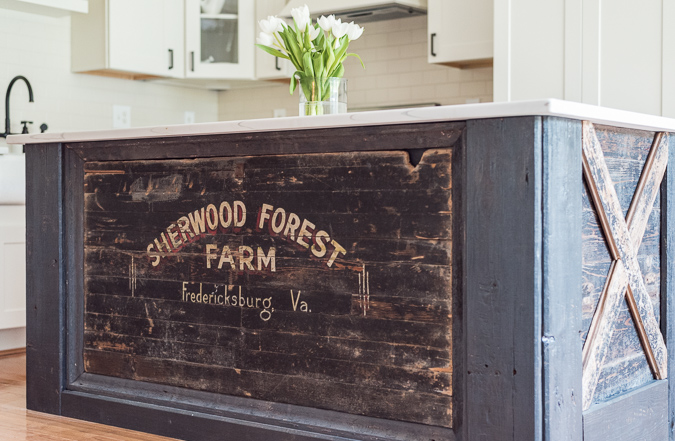 Custom Sherwood Forest Farm distressed kitchen island with barn doors by Grit Antiques
