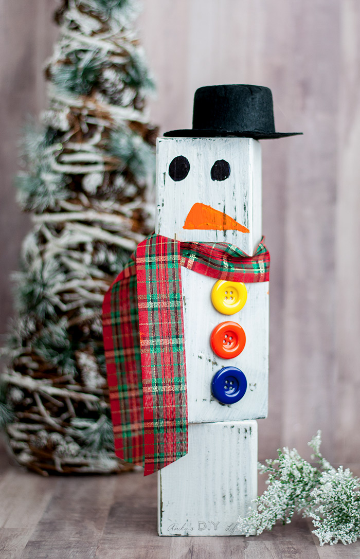 Wood block snowman by Anika's DIY Life, featured on Funky Junk Interiors