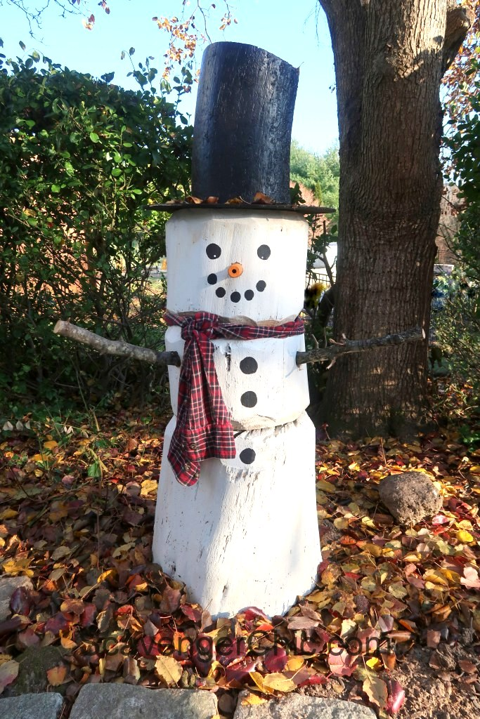 Log outdoor winter snowman by Scavenger Chic, featured on Funky Junk Interiors