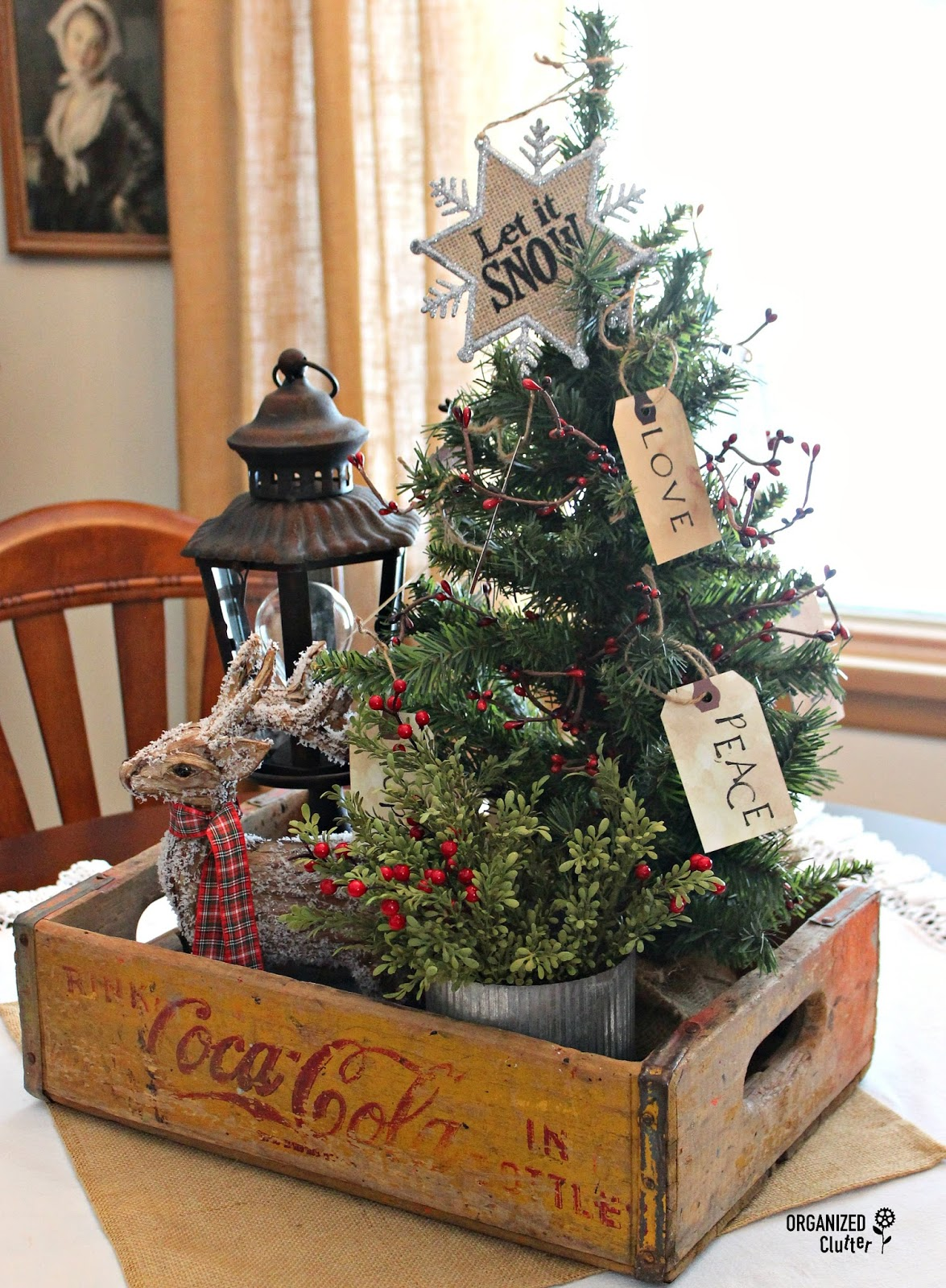 Christmas tree scene in a vintage Coke crate, part of a Christmas home tour by Organized Clutter, featured on Funky Junk Interiors