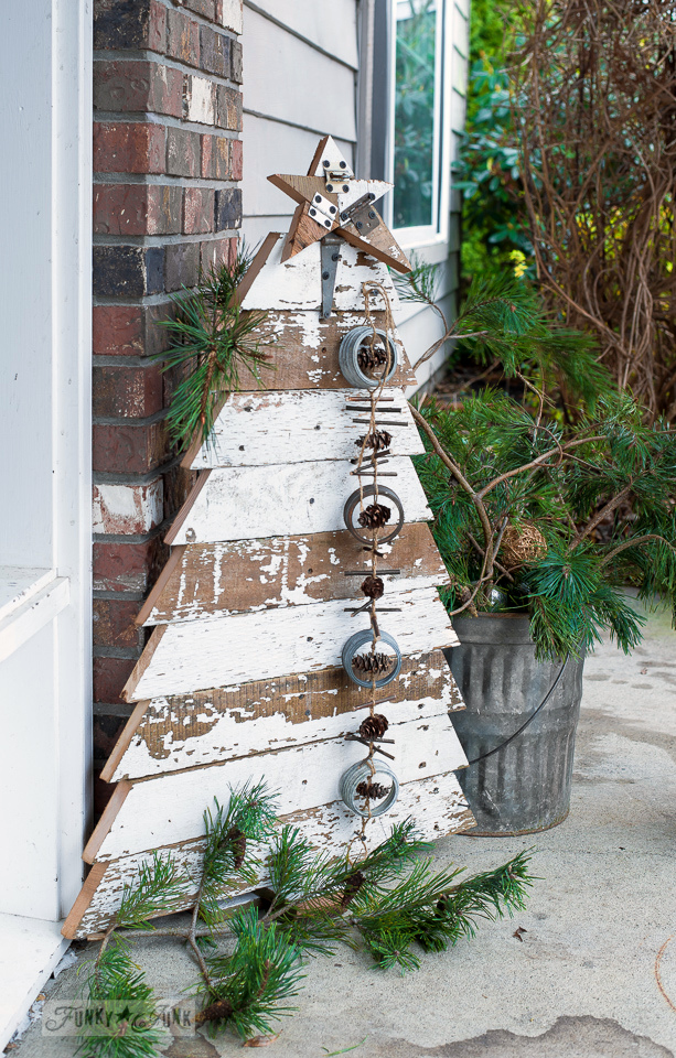 DIY this handmade reclaimed wood Christmas tree plus salvaged star, perfect for the front porch | funkyjunkinteriors.net #funkyjunkinteriors #reclaimedwood #christmastrees #christmastree #christmasdecor