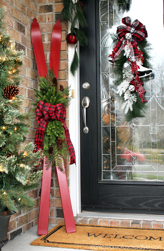 Repurposed painted skis on a Christmas porch by Confessions of a Serial Do It Yourselfer featured on Funky Junk Interiors