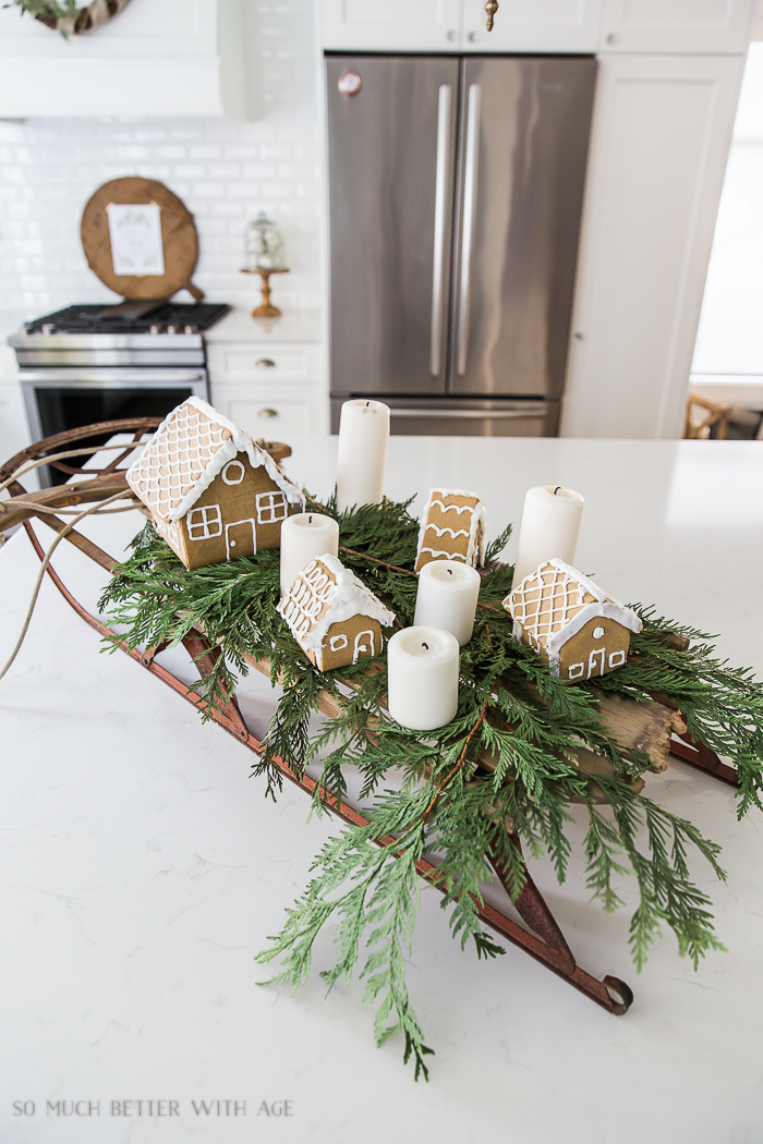 Gingerbread village on a sleigh, part of a Christmas Home Tour by So Much Better With Age, featured on Funky Junk Interiors