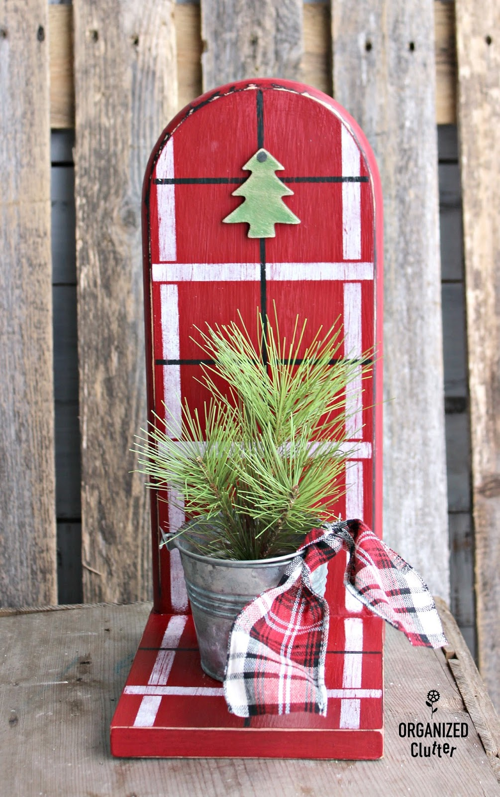 Repurposed paper towel holder to plaid painted Christmas shelf by Organized Clutter, featured on Funky Junk Interiors