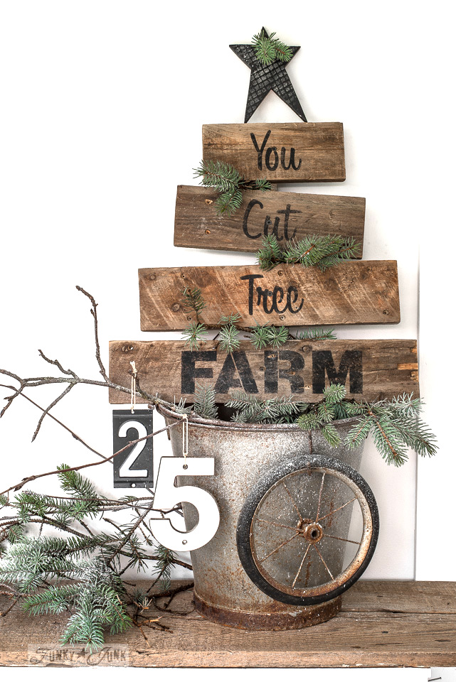 Learn how to build this pallet wood You Cut Tree Farm Christmas tree shaped sign using scrap wood and Christmas stencils from Funky Junk's Old Sign Stencils. Click to read full tutorial.