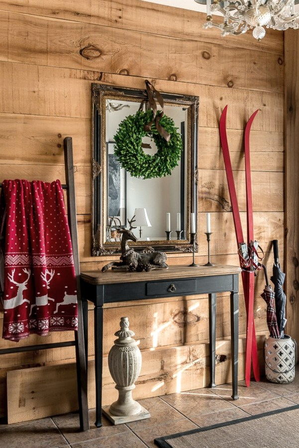 Gorgeous rustic Christmas entry with wood wall and red skis by Orphans with Makeup, featured on Funky Junk Interiors