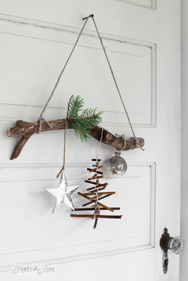 Easy twig Christmas tree hung from a branch door | funkyjunkinteriors.net