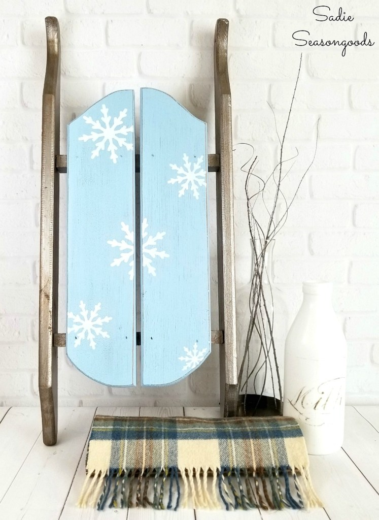 Snowflake stenciled vintage sleigh for winter decor by Sadie Seasongoods, featured on Funky Junk Interiors